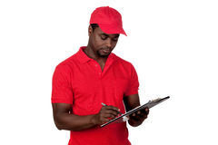 Worker courier with red uniform. Isolated on a over white background royalty free stock image