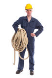 Worker in coverall and yellow helmet with large thick rope Royalty Free Stock Photos