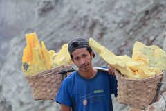 Worker at crater Ijen Volcano Stock Photos