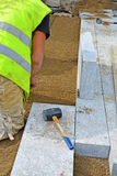 Worker creating screeding sand bedding Stock Photography