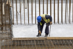 Worker with crowbar removing wooden formworks Royalty Free Stock Photos