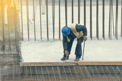 Worker with crowbar removing wooden formworks 2 Royalty Free Stock Images