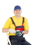 Worker with cup of tea. Stock Photo