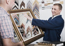 Worker and customer in wood frames atelier Royalty Free Stock Image