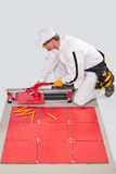Worker cut ceramic tile machine Royalty Free Stock Photo