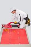 Worker cut ceramic tile machine Royalty Free Stock Photo