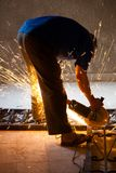 Worker cut iron Royalty Free Stock Photography