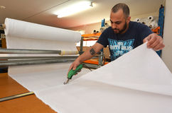 Worker cut new fabric sheet for the new National flag of New Zea Stock Photo