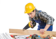 A worker cut a plank of wood Royalty Free Stock Photos