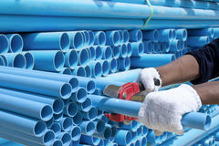 Worker cut pvc pipe Stock Photography