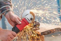 Worker cuts metal electric saw. Royalty Free Stock Image