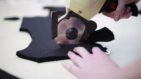 Worker cuts the pattern. stock video