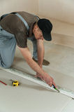 Worker cuts a piece of drywall Royalty Free Stock Photos