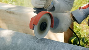 Worker, cuts the pipe from asbestos stock footage