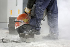 Worker cutting the brick pavers Stock Images