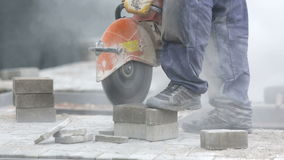 Worker cutting the brick pavers stock footage