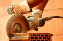Worker cutting bricks. Hard work stock images