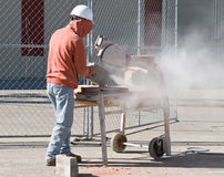 Worker Cutting Cement Block Stock Photography