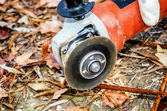 Worker cutting construction  stee netl with Angle Grinder Mashin. E closeup Royalty Free Stock Photo