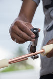 Worker cutting copper pipe of air conditioner Royalty Free Stock Photo