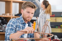 Worker cutting copper pipe air conditioner Royalty Free Stock Photo