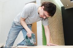 Worker cutting floor board Royalty Free Stock Images
