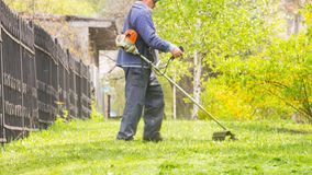 Worker cutting grass royalty free stock photos