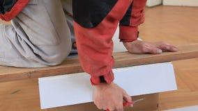 Worker cutting gypsum board stock footage