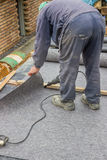 Worker cutting insulation material for basement wall 2 Royalty Free Stock Photos
