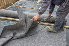Worker cutting insulation material for basement wall Royalty Free Stock Image
