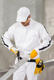 Worker cutting lath by stencil Stock Photo