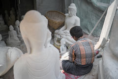Worker cutting the marble buddha statue Royalty Free Stock Images