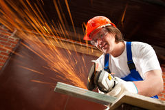 Worker cutting metal Royalty Free Stock Photo