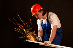 Worker cutting metal Stock Images