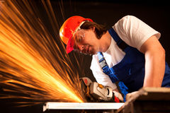 Worker cutting metal royalty free stock photos