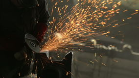 Worker cutting metal in the factory stock footage