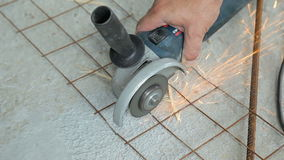 Worker cutting metal grid with angle grinder stock footage
