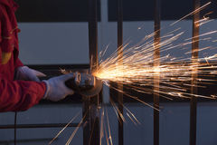 Worker cutting metal Royalty Free Stock Image