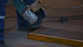 Worker cutting the metal stock video footage