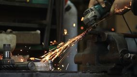 Worker cutting metal with a grinder stock footage