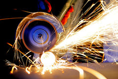 Worker cutting metal with grinder Stock Images