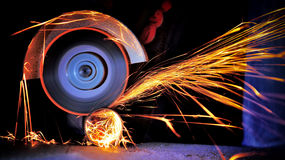 Worker cutting metal with grinder Royalty Free Stock Photos