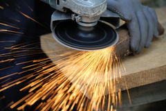 Worker cutting metal with grinder Royalty Free Stock Images