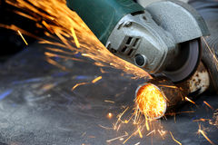 Worker cutting metal with grinder Royalty Free Stock Photo
