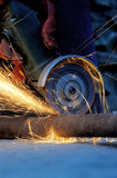 Worker cutting metal with grinder Royalty Free Stock Image