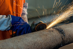 Worker cutting metal with grinder. Sparks while grinding iron Royalty Free Stock Images