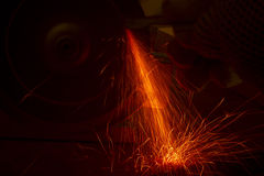 Worker cutting metal. With many bright sparks Stock Photography