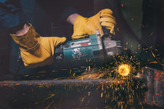 Worker cutting metal Royalty Free Stock Photography