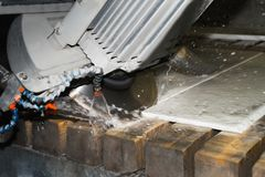 Worker cutting metal ,stone production,beautiful stone cutting royalty free stock image