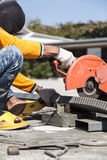 Worker cutting metal with unsafety position Stock Image